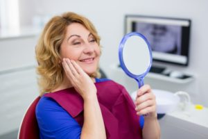 older woman happy with dental implants in Dix Hills